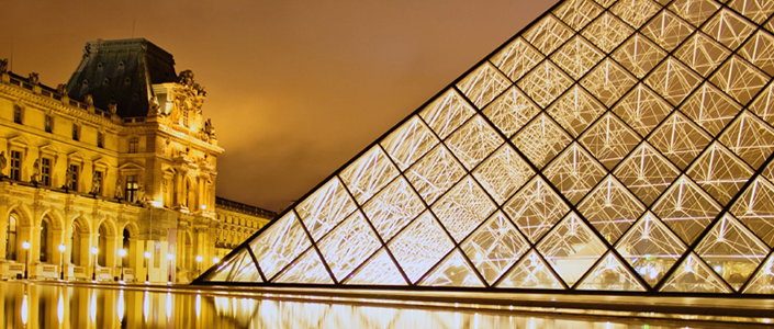 Paris Louvre pyramid by night